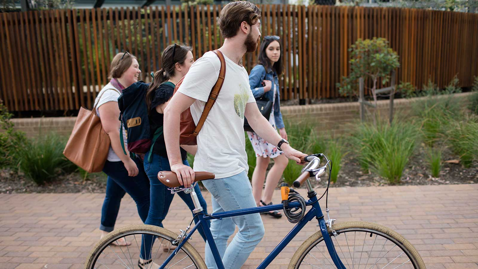 Students walking with bike