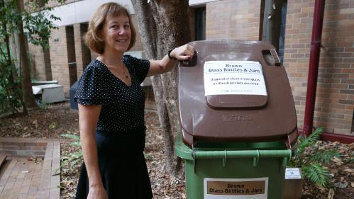 A staff member who is an environmental champion with bottle recycling