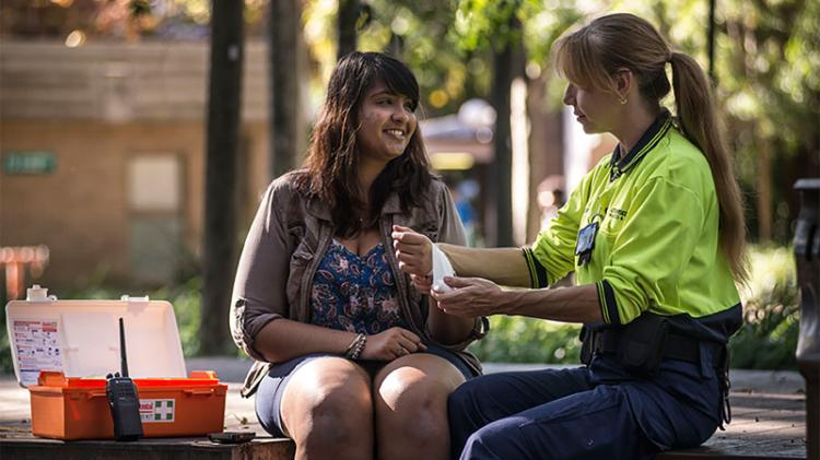 A student receiving first aid assistance from UOW Security