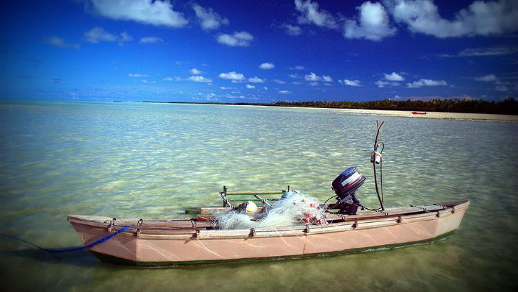 A fishing boat on a pacific island