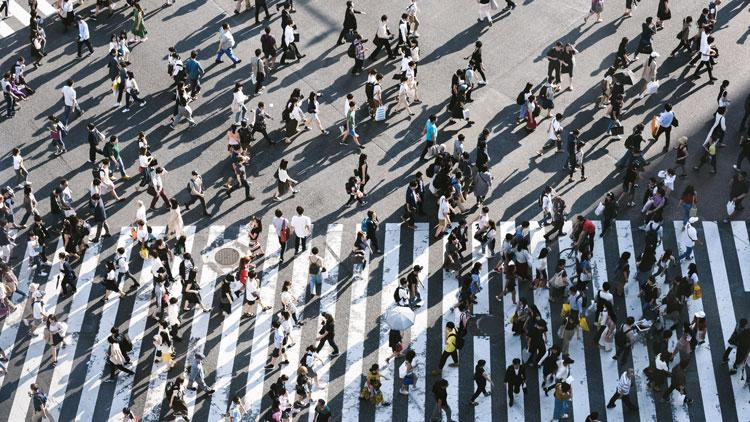 Birdseye view of people walking across pedestrian crossing
