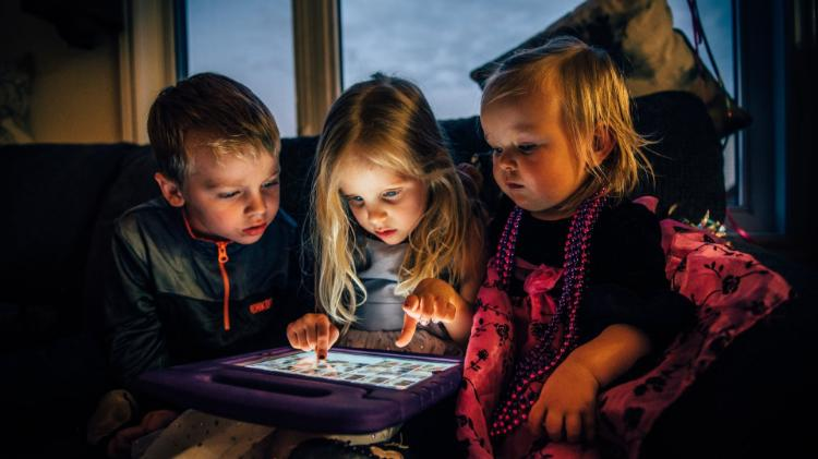 Photo of Children watching tablet computer