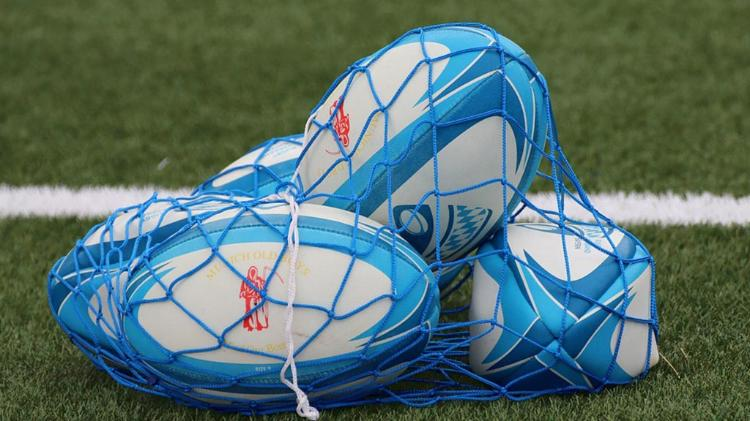 Rugby balls in netted bag