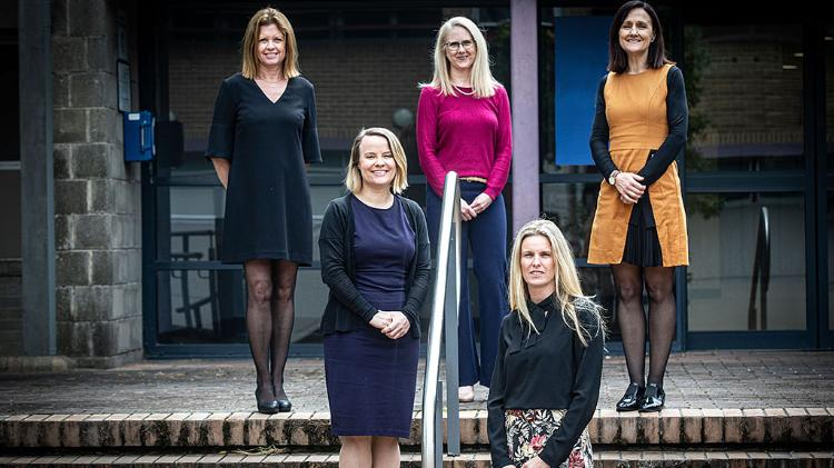Left to right - standing on steps at Wollongong Campus.  Associate Professor Sharon Tindall-Ford, Professor Sue Bennett, Dr Kellie Buckley-Walker, Dr Kylie Lipscombe, and Associate Professor Jessica Mantei