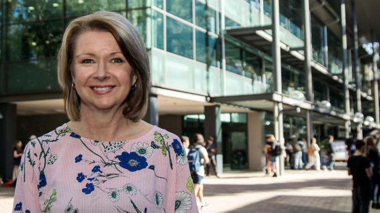 A portrait of Margie Jantti, Director of Library Services, outside the Wollongong Campus Library