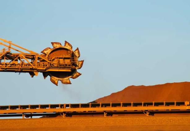 blue sky with orange abstract mining equipment