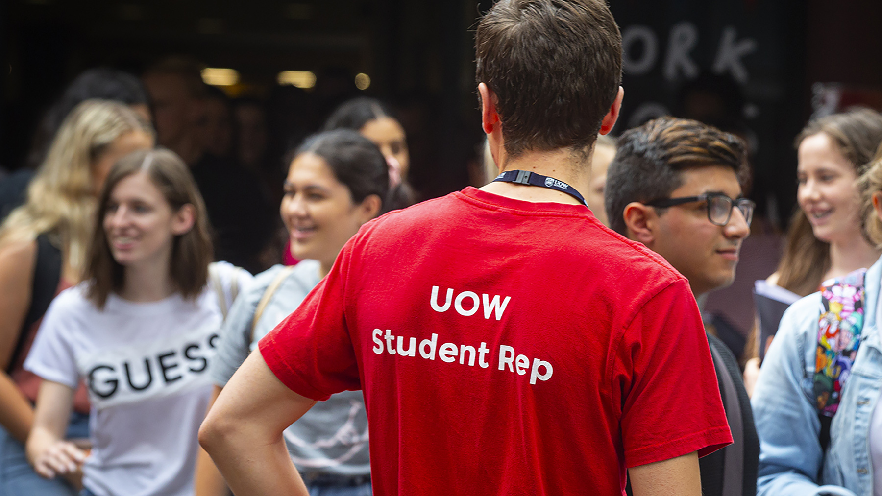 A UOW student rep guides new students at an event on campus