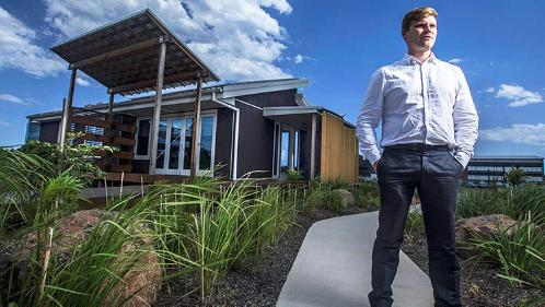 Lloyd Nicol stands in front of the winning Solar Decathlon sustainble house