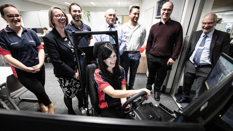 UOW Motorsport's Gabrielle Casey in driving simulator