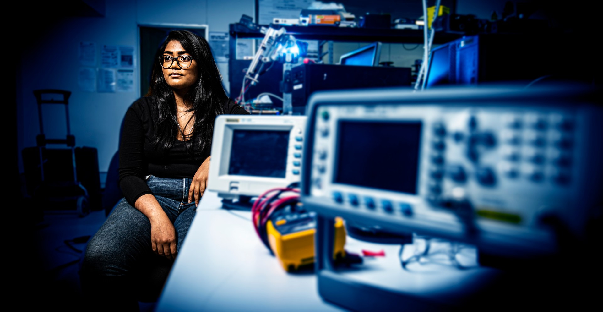 UOW graduate Geetika Maddirala sits at a computer in a medical lab. Photo: Paul Jones