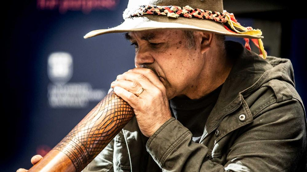 An Indigenous didgeridoo player at the Reconciliation Action Plan launch at UOW.