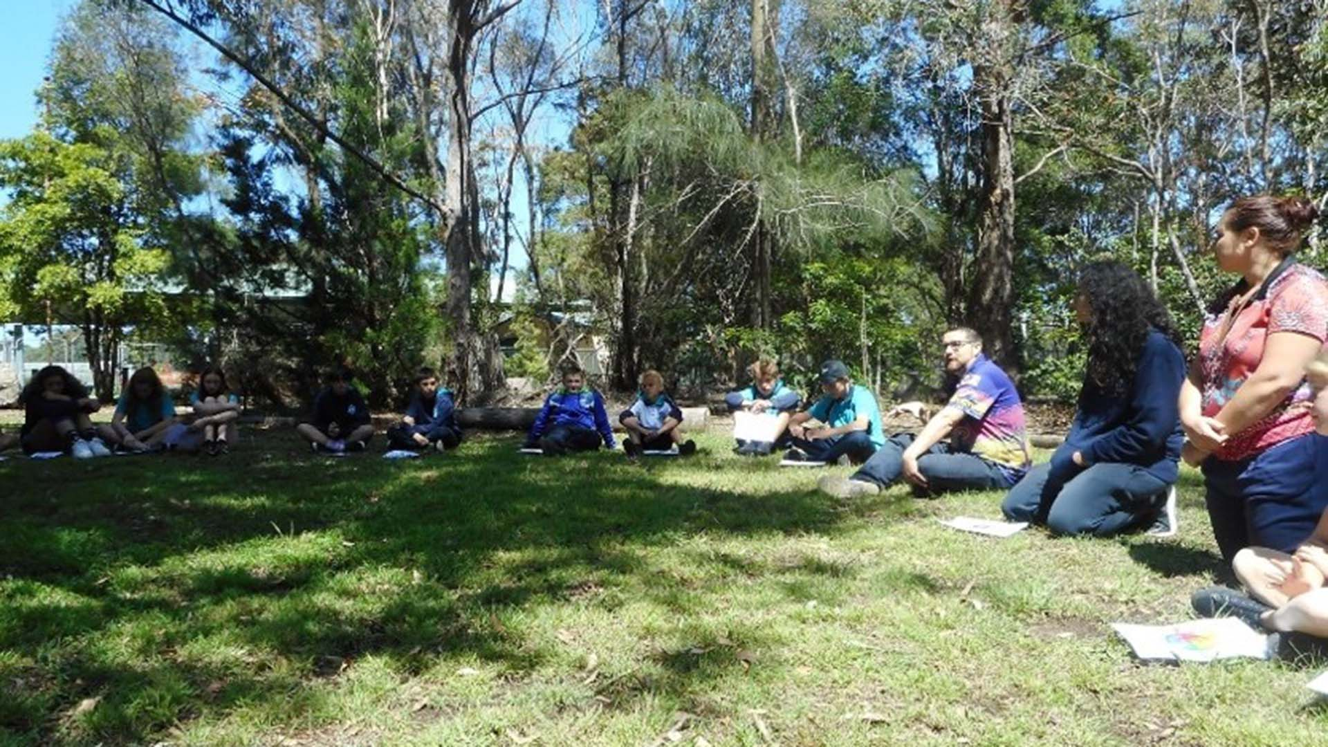 Yarning circle with UOW Outreach staff and school students