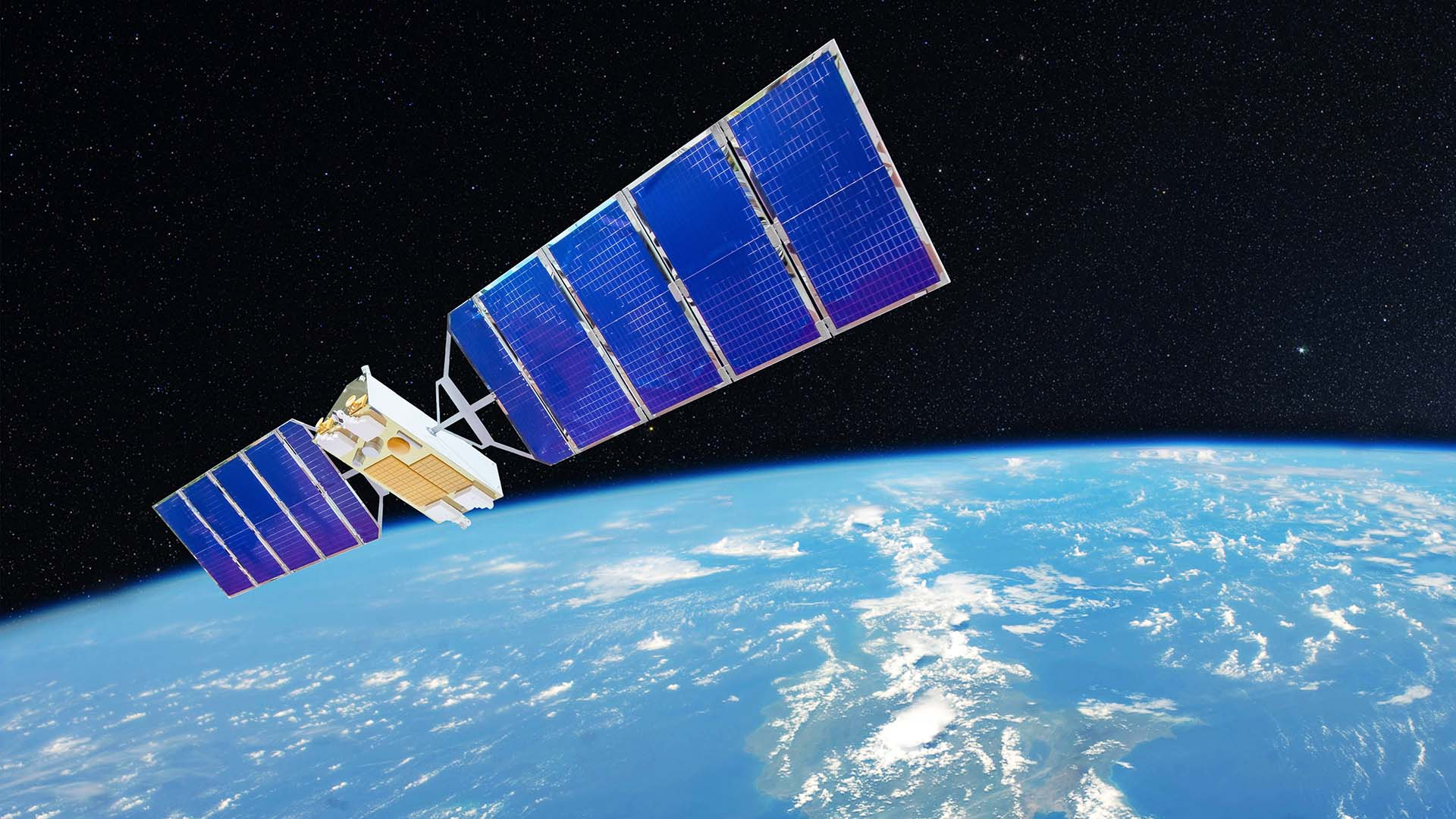 Stock image of a satellite flying above earth (credit: aapsky/Shutterstock)
